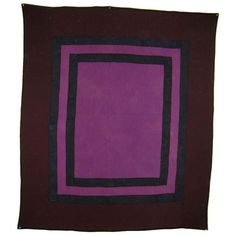 Amish Quilt: Center Square  America. Ohio.  Early 20th-Century  Although Midwestern Amish quilts were typically made of cotton, this fine example is of deep hues of purple and brown with black inner frames in wool. Traditionally hand-quilted in black thread are feather, wreath, parallel line and shell patterns, skillfully stitched. Backing of plain muslin.  Price  $7,800