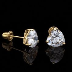 These 14k solid yellow gold stud earrings contain heart shaped glossy diamonds in a prong setting. The stones are 2 excellent cut D VVS1 simulated diamonds with a total carat weight of 0.50Ct. Product Description   Metal 14k Yellow Gold   Style Simulated Diamond Stud Earrings   Total Carat...