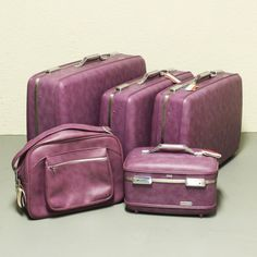 Vintage Plum-colored American Tourister Luggage set-- photo only. I saw a set in a nearby vintage store and LOVED it!