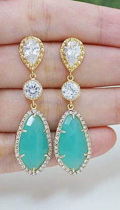 pretty. i can totally see jocey wearing these, they are right up her ally. mint + gold earrings from earringsnation. #mintwedding #weddingjewelry #earrings  http://www.earringsnation.com/bridal-jewelry/lux-mint-opal-with-cubic-zirconia-drop-earrings-gold-tone#.UstAcGRDuTZ