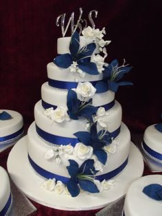 5 Tier Wedding Cake With Blue Sugar Crafted Lilies Www Frescofoods Co Nz