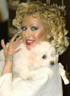 Christina Aguilera with her dog Lucy. ♡... Re-pin by StoneArtUSA.com ~ affordable custom pet memorials for everyone.