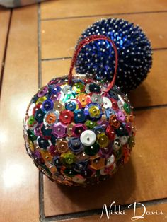 Tonight's DIY Christmas ornament in the foreground. Made from sequins, pins, and a styrofoam ball, this is a great multi-generational project. For this one, I threaded the pins, and my son placed them. Would also be a great project to do with a grandparent or friend. The teamwork cut our time tremendously! Alternate project behind it that I did a few years ago. Much heavier because I added the tall beads as well, but just as pretty! #DIYOrnaments2013 #Michaels