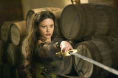 She had her sword pointed at his throat, and it was clear she knew how to use it.