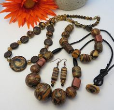 Polymer clay necklaces, bracelet and earrings by Nee Nee Ree