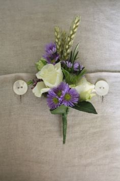 White & purple buttonhole