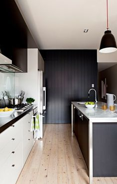 A timeless black and white scheme suits this small kitchen perfectly - Home Beautiful