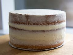 Instead of completely coating the entire cake, this unique cake decorating technique spreads the frosting thin enough to leave the layers...