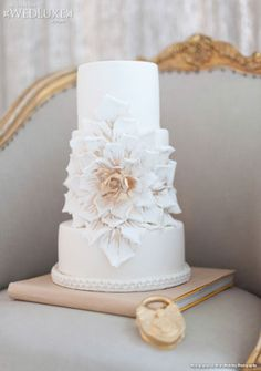 Stunning three tier #wedding #cake designed and created by @Kien and Sweet. Sugar flower with hand painted gold accents! LOVE! Seen on: City-Chic Style   WedLuxe Magazine Photo credit: Blush Photography