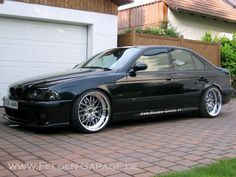 BMW E39 M5 beautiful sleek black with smoke lens and polished rims low profile tires