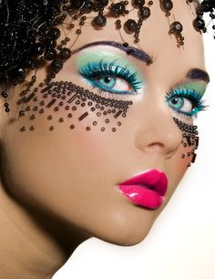 Turquoise aqua eyes, coral lips and beaded cheeks. Exquisite costume makeup. I'd love to recreate this :)