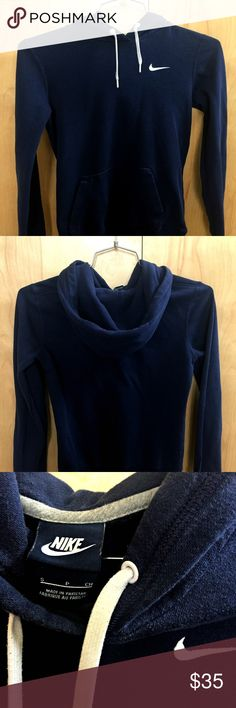Lightweight Navy Nike Hoodie - Women's Small This hoodie is perfect for running or exercising when it is cold out. It is a perfect extra layer of warmth that breaths so you don't overheat. My favorite part about this item though is how flattering it is to your figure. It is more form-fitting than usual hoodies but in just the right way. It hits just the right spots snuggly and just the right spots loosely to slim you right up. It is only lightly used and is a slightly lighter navy color than…