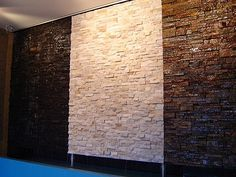 Stacked Stone Water Wall 1...   Stacked Stone Water Walls have a richness of texture and colour that will add timeless elegance to any indoor or outdoor space. This is an example of three different looks you can achieve in charcoal, white quartz and earth tones. Other colours are available to complement your decor.