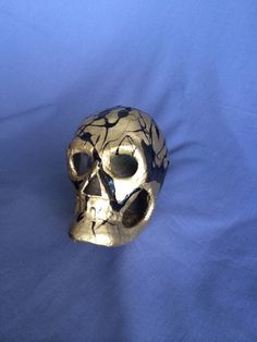 DIY paper mâché skull! Spray paint it whatever color you like and then get a gel medium and mix another color and splatter onto skull and hang dry upside down. :)