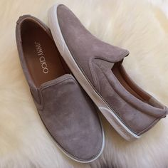 "Jimmy Choo ""Demi"" Suede Slip-On Sneakers Taupe colored suede slip-on sneakers with silver zipper piping. Would keep if they were a half size bigger. Will fit a size 8 best (I always half size up in Jimmy Choo). ❤️no trades. Jimmy Choo Shoes Sneakers"
