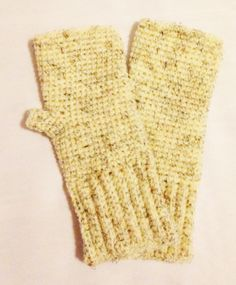 These warm Fingerless Mittens were crocheted using an acrylic and wool blend yarn in a beige color flecked with black and brown. Measurements Cuff 3 inches long 3 3/4 inch wide Mitten 5 inches long 4 inches wide Total 8 inches in length Will fit small to medium sized hands. Gentle handwash and lay flat to dry for best results and longer life.