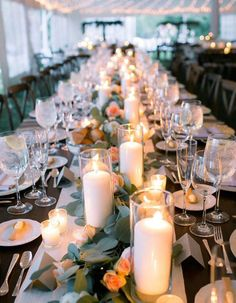 Single-flame candles create the perfect ambiance for any banquet-style wedding reception table.