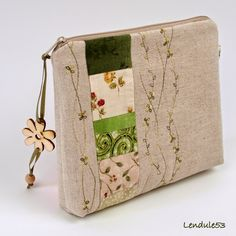 Stitched zipper pouch with pieced fabric strips
