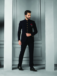 An Indian substitute to the western two-piece suits, Bandhgalas are more popular as Jodhpur Suits. Mens Indian Wear, Indian Groom Wear, Indian Men Fashion, Mens Fashion Suits, Men's Fashion, Indian Wedding Clothes For Men, Sherwani For Men Wedding, Wedding Dress Men, Wedding Outfits For Men