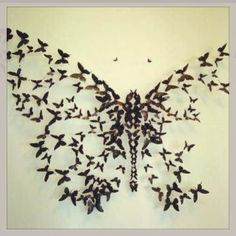 Beautiful butterfly tattoo...what if i used mara's foot prints instead of butterflies?