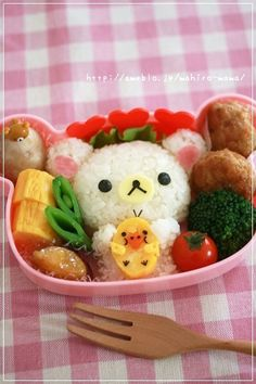 korilakkuma rice ball, you can get this bento box at http://www.allthingsforsale.com/bento-box-lunch-box/2977-korilakkuma-die-cut-bento-lunch-box-with-removable-divider-4974413585644.html