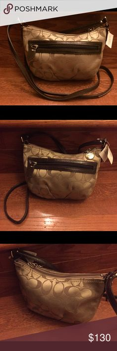 """Coach Signature Crossbody Shoulder Purse Coach Signature Sateen Pleated Crossbody Shoulder Bag Purse   Brand New W/Tags   Coach signature khaki (brown) sateen jacquard with brown leather trim Silvertone hardware  Top zippered closure with Coach embossed medallion Exterior zippered slip pocket  Embossed Coach leather mini hangtag Solid brown interior lining with zippered wall pocket with leather pull Coach style #44744 Measures approx: 8"""" long x 6"""" high  Shoulder strap measures approx: 23""""…"""