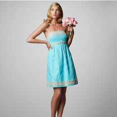 Lilly Pulitzer Jacquard Betsey Dress in Turquoise Nearly brand new Lilly Pulitzer Jacquard Betsey Dress in Turquoise Blue. This dress is strapless, flirty, and sophisticated! I bought this directly from the Lilly store and wore it once to a wedding. Has since been dry cleaned and unworn. The fabric of this dress is beautiful - a bright but sophisticated color with a subtle jacquard pattern and nice weight to it. The gold trim around the empire bust and bottom is really beautiful. Size 2 but…