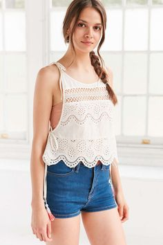 fe715173cf Sweetly embroidered cotton eyelet cami with rainbow tassels at the sides