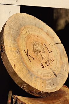 For our wedding, Kyle cut these rounds in the 114 degree Arkansas heat. I burned our initials and wedding dates on each one, and then stamped them with a tree stamp.