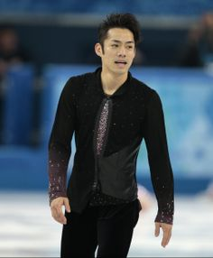 Daisuke Takahashi of Japan leaves the ice after competing in the men's short program figure skating competition at the Iceberg Skating Palac...