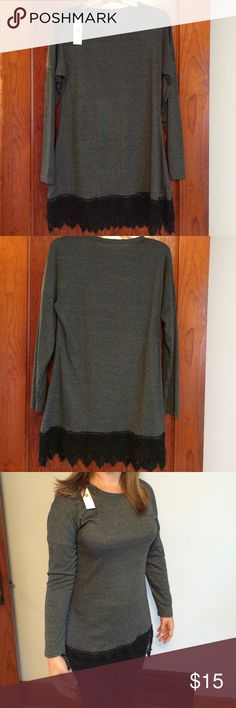 """NWT Gray Lace Tunic This is a NWT long sleeve gray T-shirt fabric tunic with black lace trim.  It was purchased on line and did not fit my daughter correctly. Tag says size L but it fits more like a M. From underarm seam to underarm seam measures 18"""". From shoulder seam to hem measures 30"""". Tops Tunics"""