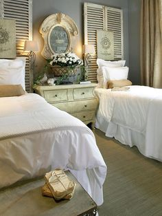 shutter as headboards =)  You could also do this for a queen size bed.  What a great guest room.  I just love this idea!