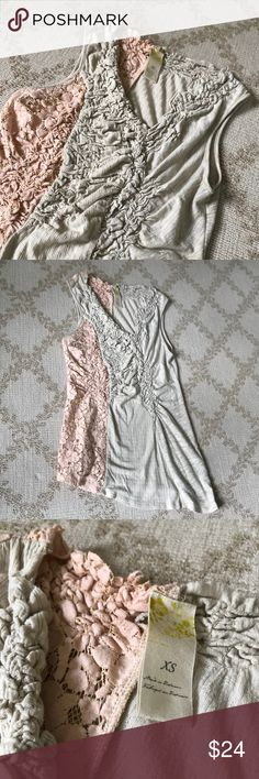 """Anthropologie lace ruched top Adorable beige/pale pink split neck tank with ruched front and contrasting lace material along the length of the top(front and back). Asymmetric cut at hem. Cotton blend. See tag. Cold wash. Approximate measurements flat: 15"""" bust, 26"""" shoulder to lowest portion of hem. Good preowned condition. The perfect feminine top for layering 🌷 Anthropologie Tops Tank Tops"""