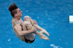 Hair raising:    France's Matthieu Rosset competes during a men's 3-meter…