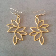 Long Leaves Earrings, dangle and drop earrings. Matte finished drops design. Made of 14 carat gold plated brass base. Dimensions: Length: 2 inch
