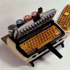 What's better than eating a keyboard-shaped waffle for breakfast? Chris Dimino created this waffle iron from an old typewriter keyboard. The waffles come out of the iron in the shape of a keyboard, which is perfect for any breakfast-loving nerd. Toaster Design, Corona Typewriter, Typewriter Keys, Waffle Iron, Waffle Waffle, Cool Gadgets, Unique Gadgets, Amazing Gadgets, Geek Gadgets