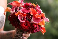 red bridal bouquet with crystals http://www.chrisdiset.com/main.php#!/images/wedding-images/details/40