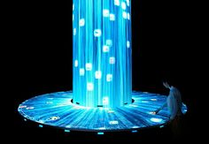 Visitors can touch the images that flow down the length of the waterfall and transfer the digital pictures onto their smartphones. the photos are accompanied by detailed information about the origin and importance of the food, which they can then take home with them. | teamlab expo exhibitsjapan pavilion
