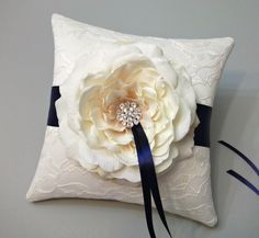 Lace Ring Bearer Pillow with Ivory Rose and Navy Blue Ribbon. $52.00, via Etsy.