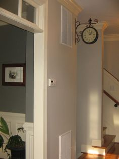 Revere Pewter in foyer. Chelsea Gray in office.