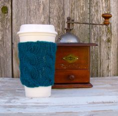 A personal favorite from my Etsy shop https://www.etsy.com/listing/180715288/coffee-cup-sleeve-coffee-mug-cozy-cable