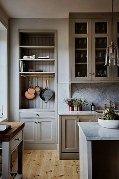 A serene farmhouse kitchen design with warm putty gray painted kitchen cabinets, beadboard, and marble backsplash in a gorgeous classic kitchen. Kitchen Corner, New Kitchen, Kitchen Decor, Kitchen Ideas, Kitchen Paint, Warm Grey Kitchen, Kitchen Layout, Minimal Kitchen, 1970s Kitchen