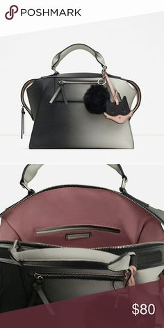 ZARA Ombre Bowling Bag with Poof Zara graduated ombre bag in grey/white/black fade.  Blogger & Celeb fave and sold out! Large enough to fit a standard laptop, trendy enough to wear out. Worn once in like- new condition, no flaws.   Black poof charm included, cat charm is not. Bags
