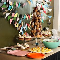 9 DIY geometric party ideas;  garland backdrop by Organize & Decorate Everything