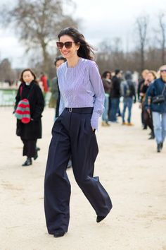 navy wide leg pants and a striped blouse.