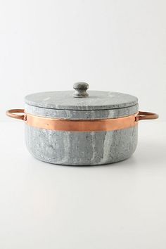 Soapstone stock pot with copper handles.