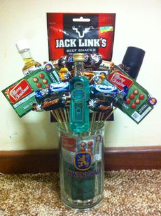 """The """"Broquet"""" that I made for my brother in-law. Perfect present for hard to buy for boys. Mini alcohols, chocolates, scratchies, mini deodorant, and jerkey. I used a large beer mug as the vase. He loved it - and I loved making it. SG"""