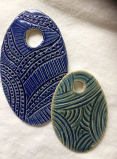 Ceramic pottery Handmade pendants -jewelry supplies 2 beautiful handcarved ceramic pendants just for you. Glazed with beautiful celadon glazes. Ready to ship! Enjoy. Free shipping These two pieces will enhance your jewelry pieces. Enjoy. One of a kind by EtienneOriginals. Have fun