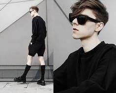 Wordsmiths United Sweater, Theory Shorts, Acne Studios Shades, Dr. Martens Shoes