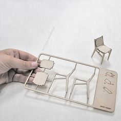1 mm birch plywood, laser-cut into a card sized kit of parts. Plywood Chair, Plywood Furniture, Laser Cut Plywood, Laser Cutting, Miniature Furniture, Doll Furniture, Gravure Laser, 3d Home, 3d Laser